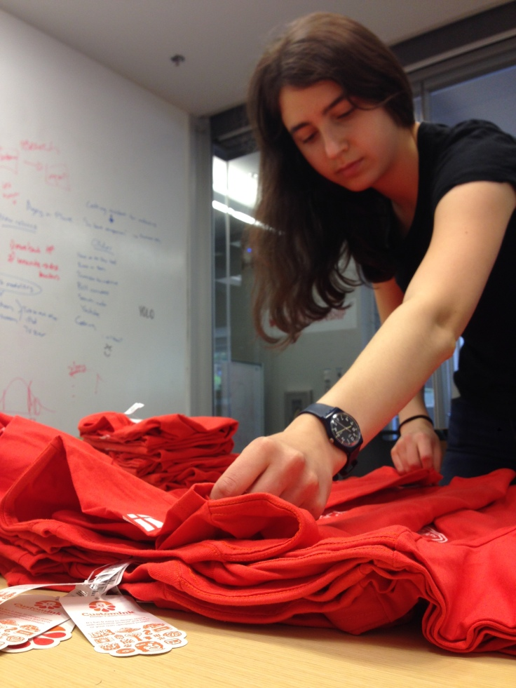 photo of interns preparing shirts for student arrival