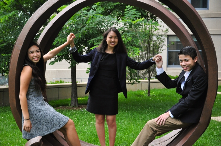 students posing on a sculpture at MIT